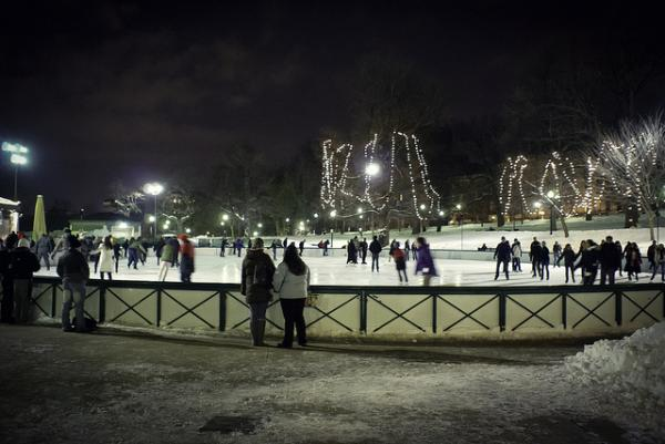 Skaters enjoy the Boston Common Frog Pond on a wintry Boston night. Does Boston need better late-night options for its residents? Will a push by the Mayor be enough to change it?