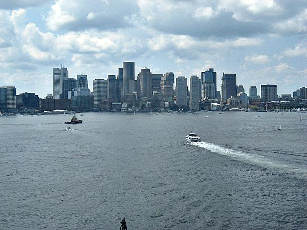 Boston Harbor and the Financial District skyline. The waters are much cleaner thanks to the heroic effort of five divers who undertook a deadly mission inside a pipe leading to the Atlantic.