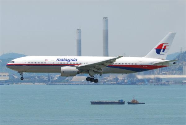 A Malaysian Airlines Boeing 777 landing at Hong Kong International Airport.