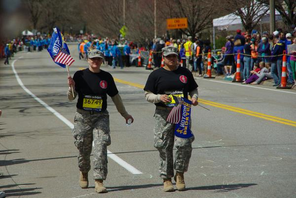 Two soldiers compete in the 2014 Boston Marathon, which went off this year without incident. On Wednesday, a Senate panel heard reports on what could have been done to prevent the 2013 Marathon bombing.