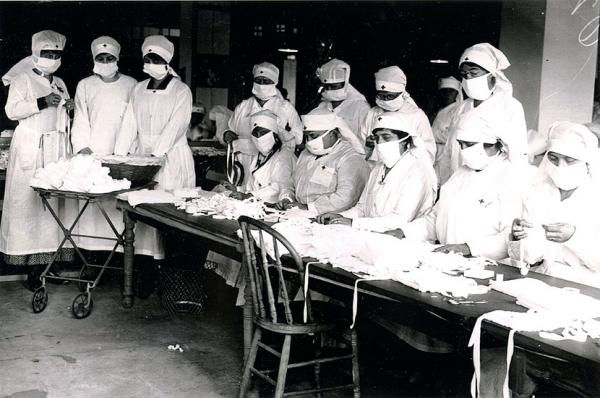 Boston Red Cross volunteers assemble masks at Camp Devens, MA.