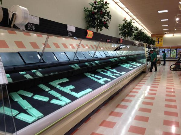 A message lines the shelves at the Somerville Market Basket.