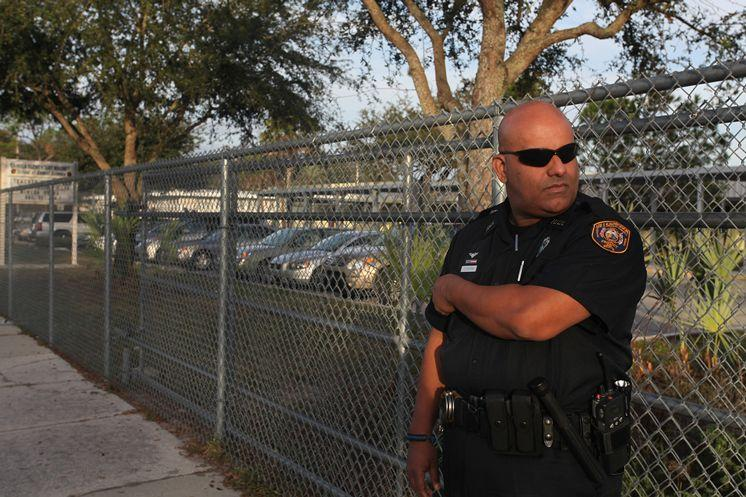 A local school resource officer monitors the campus in Tampa.