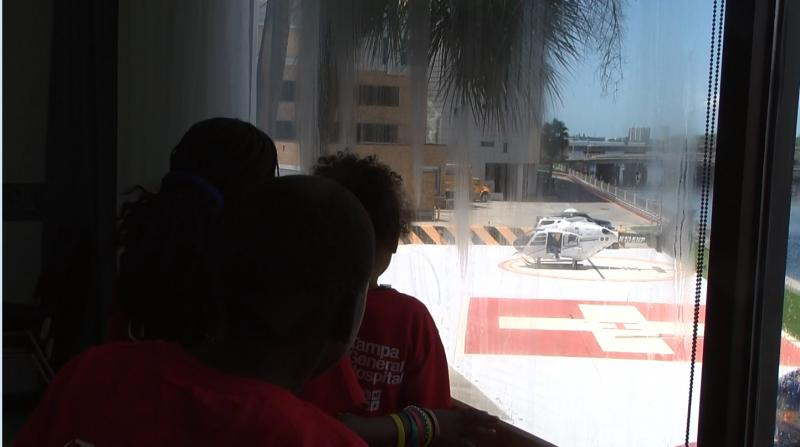 A few campers from the Sulphur Springs YMCA watch as a medical helicopter lands.