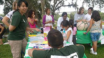 USF Health Service Corps members work with children of farmworkers at a Health Fair Fiesta in 2013.