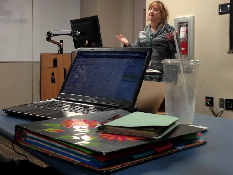 """Jodi Ray, whose in charge of health insurance counselors known as """"navigators"""" across Florida. She dropped in to talk to the class about how """"navigators"""" are helping people enroll in plans."""