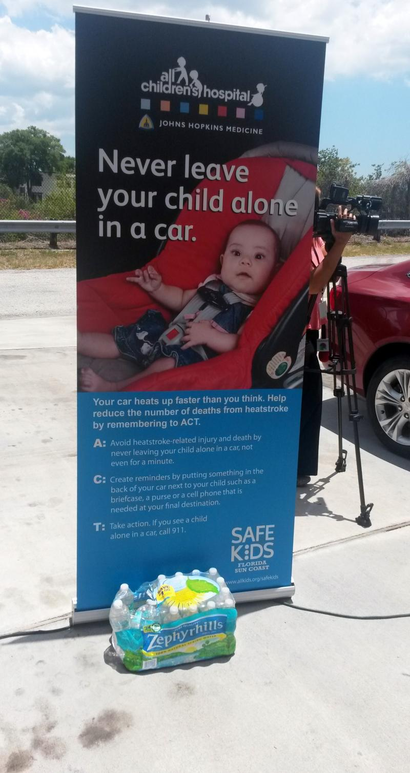 A Safe Kids Coalition poster at a hot car demonstration held in June provides a reminder and information for parents to help avoid heatstroke.