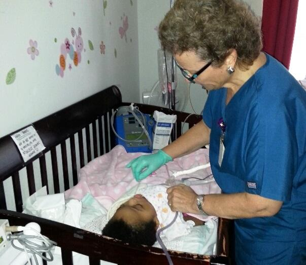 Maria Schiavi, RN, checks patient