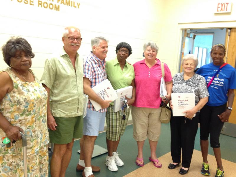 Seven graduates of the St. Petersburg YMCA Diabetes Prevention program and their Instructor Lois Huyghue