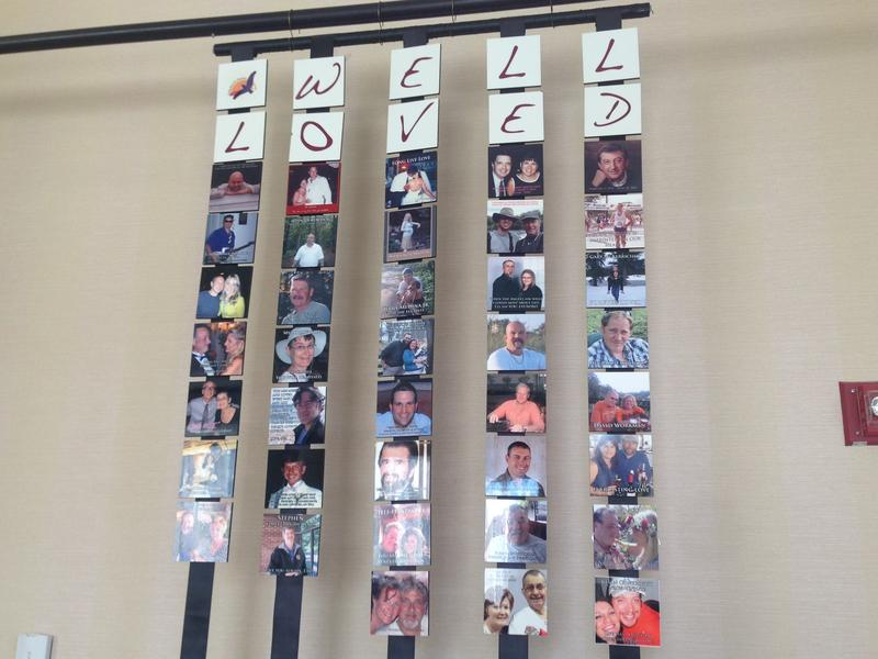 "A memory wall at Soaring Spirits International's ""Camp Widow"" showcases special moments with deceased spouses."