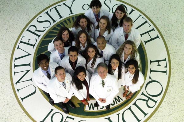 USF College of Health VP, Dr. Charles Lockwood (center bottom) and members of the 2014 class of the Morsani College of Medicine pose last August.