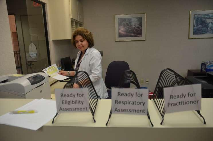 Nurse Sonia Renaud prepares the office to receive patients Thursday at Florida Hospital's Kissimmee Lung Clinic. It's the hospital's third clinic.