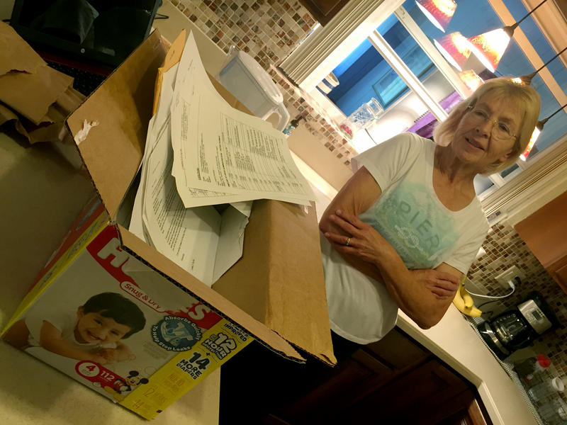 Linda Porter stands next to a large Huggies box filled with $700 worth of her son's medical records and letters to state agencies and attorneys.