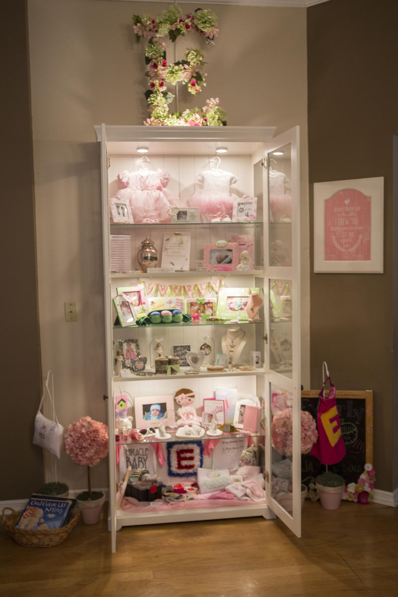 The Hopkins family keeps a curio cabinet in the dining room with keepsakes and photos of Everly.