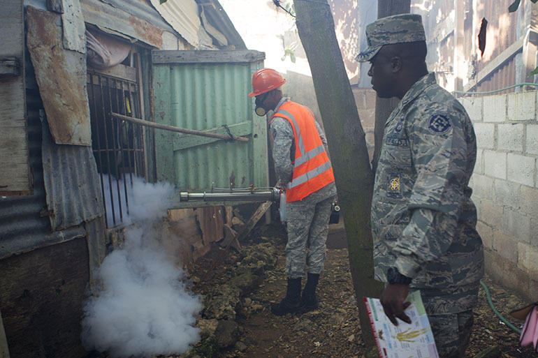 Air Force personnel in the Dominican Republic fumigate in Santo Domingo against the Aedes aegypti mosquito in February.