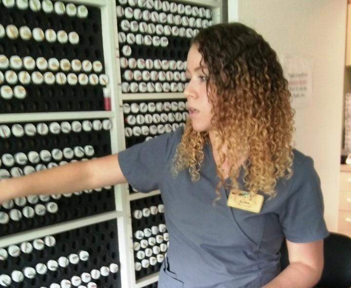 Elena Amaya, a medical assistant at the Florida Integrative Medicine Center in Sarasota. Those are bottles with small amounts of substances to test for allergies.