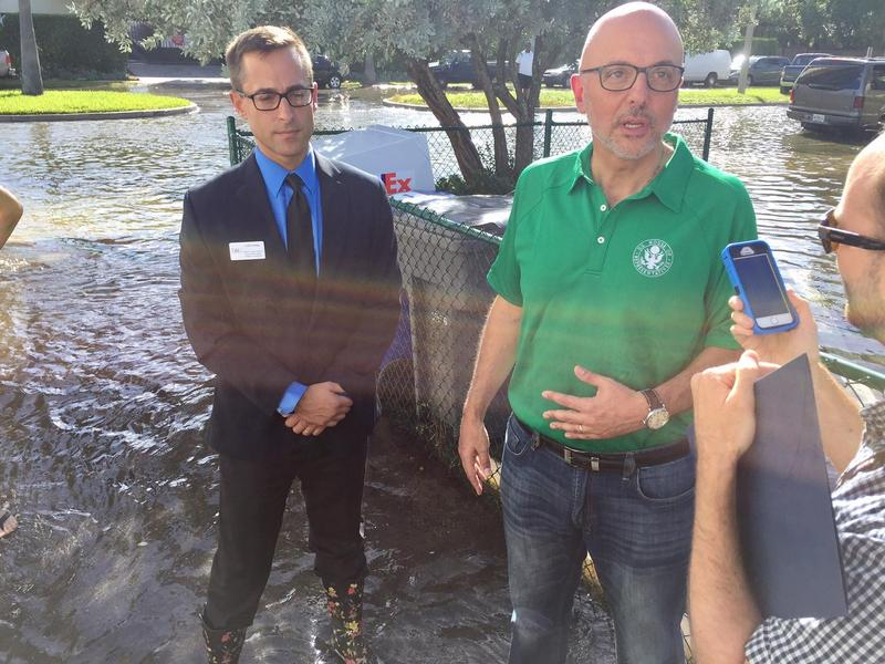 U.S. Representative Ted Deutch wades through tidal flooding in Fort Lauderdale on Oct. 17, 2016.