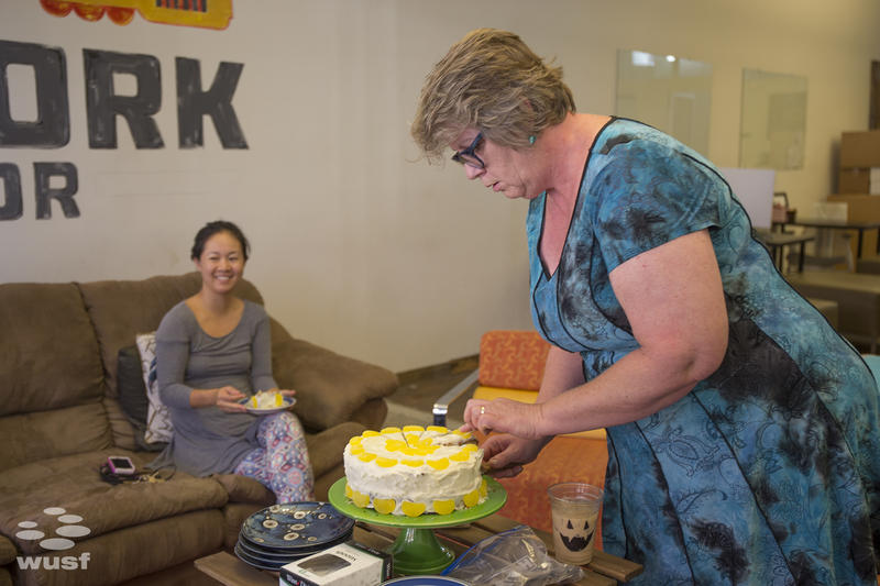 Tampa Death Cafe founder Cat Martin serves up cake during a recent conversation at the Blind Tiger Cafe in Ybor City.