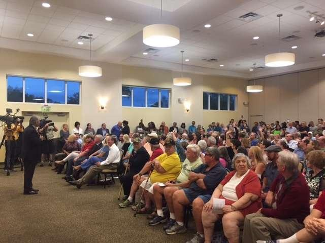 Rep. Dennis Ross (R-FL) addresses a rowdy crowd at his town hall in Clermont.