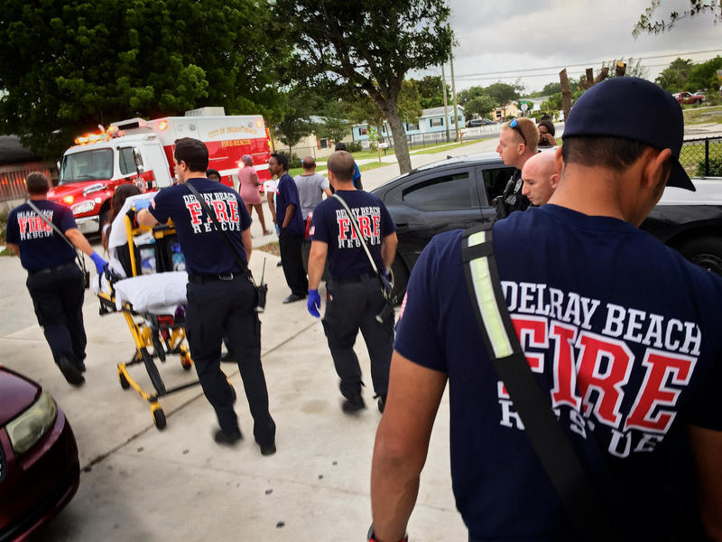 Delray Beach Fire Rescue firefighter-paramedics transport a woman overdosing on heroin to Delray Medical Center on May 19, 2017.