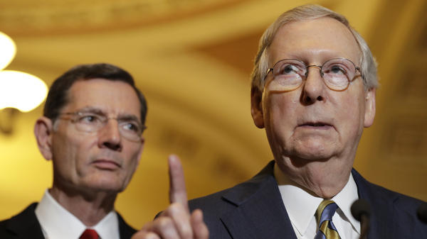 Senate Majority Leader Mitch McConnell, seen in May, announced the delay as several Republicans said they likely would not even vote to begin floor debate on the health care bill.