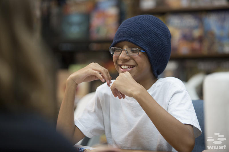Zoe Marlin, 11, laughs during a recent Dungeons & Dragons game in Clearwater.