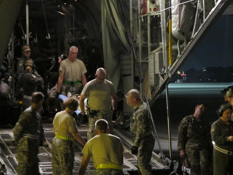 Crews on the ground in Atlanta take a patient from St. Croix off a C130.