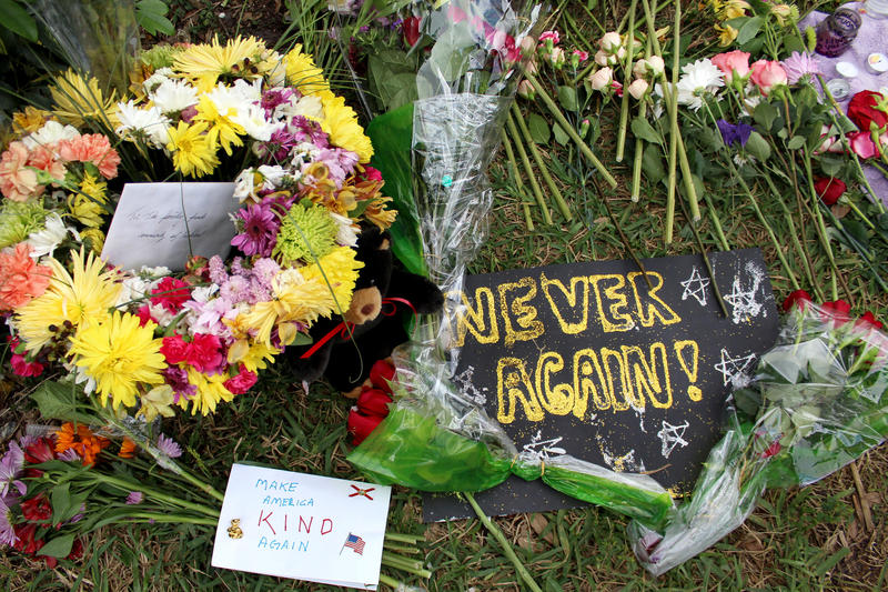 Flowers are left in Feburary in memory of the victims of the Parkland high school mass shooting.