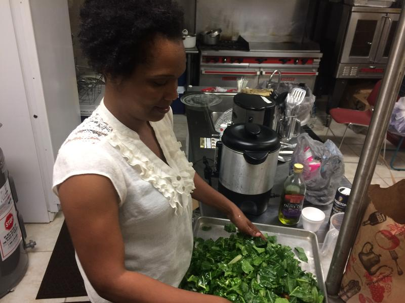 Samantha Wilson, co-founder of the Tampa Bay Collard Green Festival, prepares her greens during a friendly cook-off at Bethel Community Baptist Church.