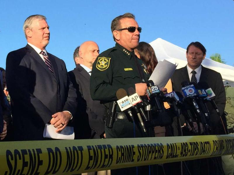 FBI Miami Special Agent in Charge Robert Lasky, left, and Broward Sheriff Scott Israel (center) brief reporters about the Stoneman Douglas High School shooting in Parkland, Fla. on Feb. 15, 2018.