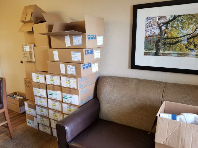 Boxes stack up at Katherine De La Rosa's temporary hotel room. She left the island because Hurricane Maria made her home uninhabitable.