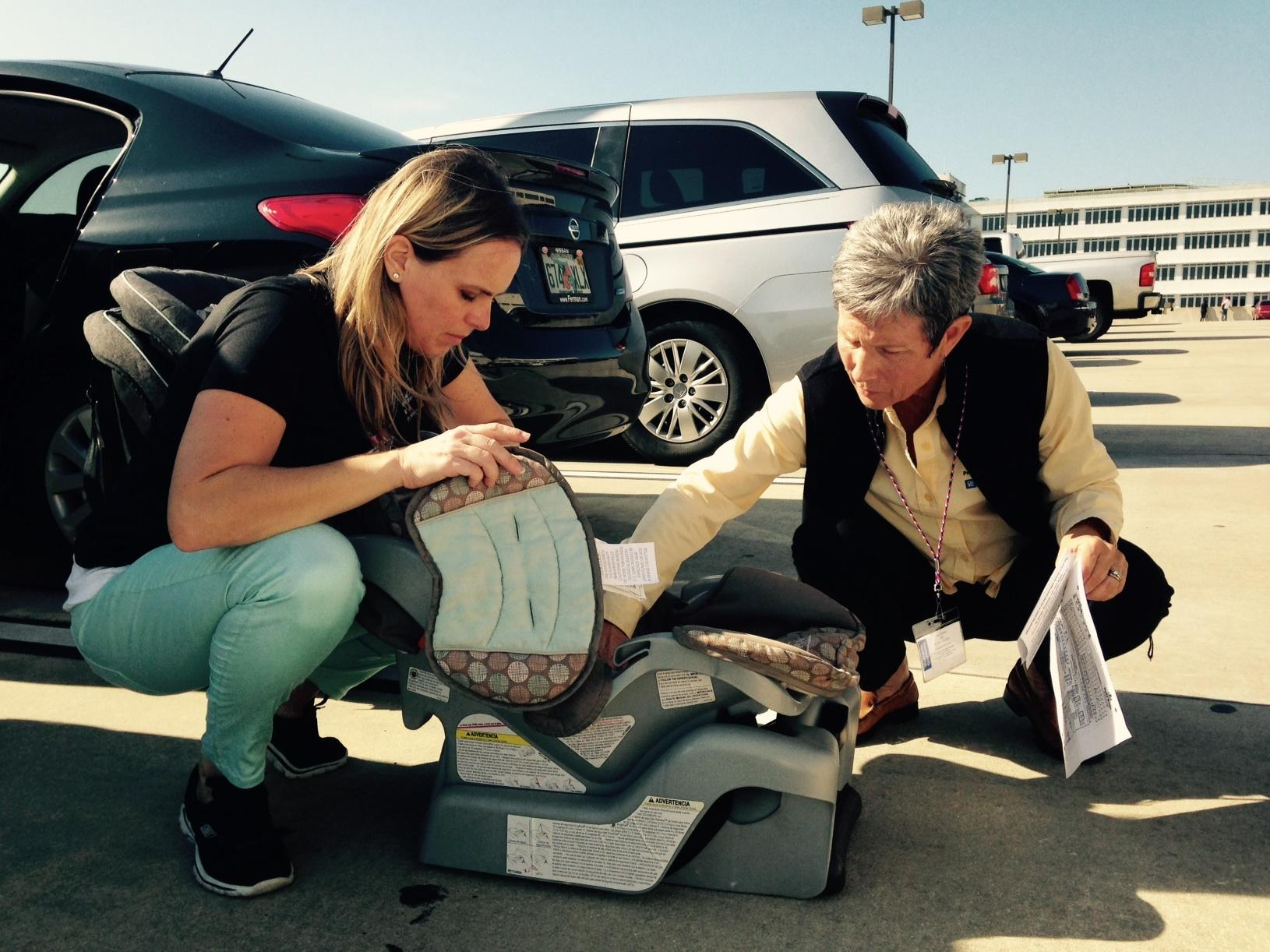 Petra Vybiralova Left Is A Program Supervisor At The Suncoast Safe Kids Coalition She Checks Out Car Seat With Trainer Peggy Klimek
