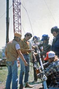 A volunteer crew erects a microwave relay tower at HPPR's first studios in Pierceville, KS in 1980
