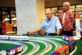 Walt and Linda Shelly operate their model train sets on display Monday at Canyon Area Library. The exhibit is made up of trains from their collection.