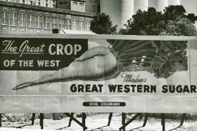 Billboard promoting the beet sugar industry outside of the Great Western Sugar factory in Ovid, CO (1967)