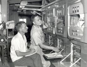 Engineer David Andrews (left) and technician Robert Oase (right) are shown by the WWVB transmitter in 1963.