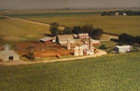 An aerial view of the Iowa farmstead where the author of this article grew up. The picture was taken in the 1980s by a flying photo salesman.