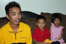 Moung Thang, a Burmese worker at the Garden City Tyson plant, with his children, Micheal, 5, and Veronica, 3