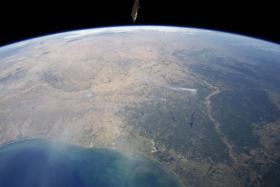 This panoramic view of east-central Texas on September 6, 2011, highlights numerous smoke plumes caused by wildfires burning across the state. The image was taken by astronauts aboard the International Space Station.