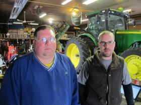Dave Beck, left, calls Dyrek Zoucha his farm's tech guru. He does most of the work managing data and software.