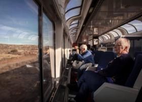 Carolyn LeBeau, right, takes in the New Mexico landscape, while Ginger Vermooten takes a photograph from the Southwest Chief.