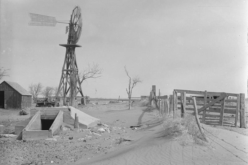 Drifting soil in a farmyard. Hartley County, Texas