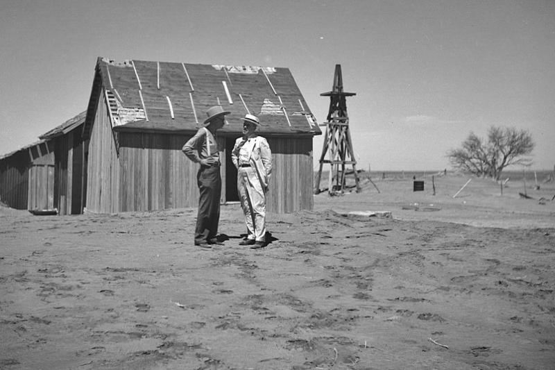 Dr. Cooke, chairman of drought committee, at abandoned farm near Guymon, Oklahoma. President's report