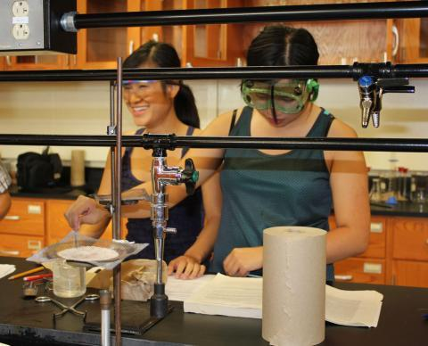 Binh Hua (left) and My Nguyen, both 18, work in the Garden City Community College chemistry lab. The two best friends graduated from high school in three years and after community college, plan to go on to universities.