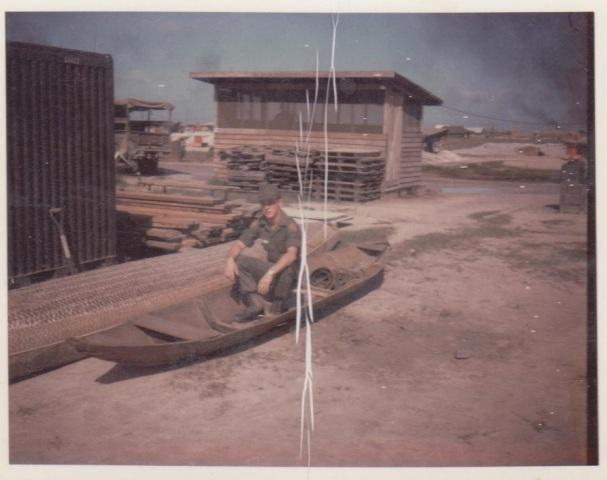 Larry sitting in a San Pan captured from the Viet Kong