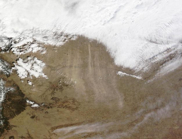 NASA's Terra satellite spied these streams of dust blowing south across Colorado, Kansas, Oklahoma, Texas and New Mexico on March 11, 2014.  Look for the streamers of pale, sand-colored stuff south of the big cloud bank.