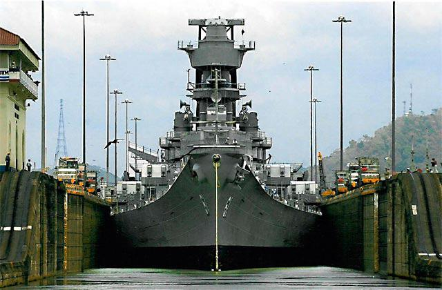 The battleship U.S.S. Iowa squeezes through the Panama Canal in 1986. The canal has seen traffic for almost 100 years.