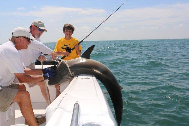 Grandson Jack reeling in the big one with Captain Mike