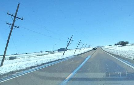 Power poles lean along Highway 50 between Lakin and Garden City.