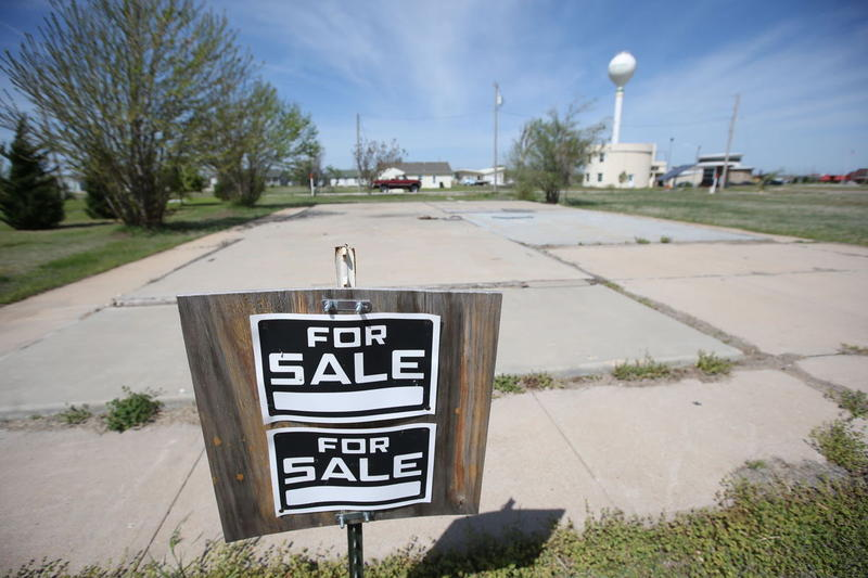 There are some abandoned lots with concrete foundations left scattered through Greensburg that are for sale.